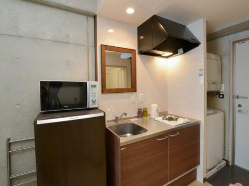 コンドミニオマキシのキッチンは各部屋にあります。また全室に洗濯機と乾燥機があるので出張や一人旅に大変便利です。